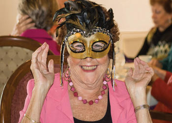 Evonn Collins, of the club's Ways and Means Committee, sported a Mardi Gras mask for fun. Photo by Be-Be Hansen.
