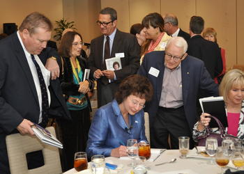 Former Tampa mayor, and author Pam Iorio signs copy of her book, Straight Forward — Ways to Live and Lead.