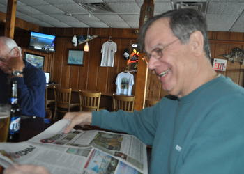 Terry Griffin, pictured at Moore's Stone Crab Restaurant, laughs as he realizes our annual April Fools' issue fooled him.
