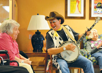 Todd Steinberg sings and plays the banjo for Kobernick-Anchin residents.