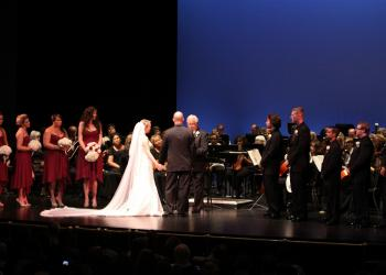 Joseph Sckowska and Emily Forbes were married by Forbes' grandfather, Warren Diehl, at the Sarasota Pops' season finale concert.