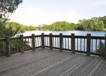 An observation deck/fishing pair overlooks a 10-acre lake with a canoe launch.