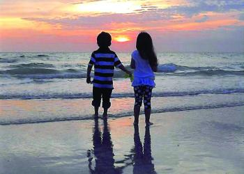 Sheila Dennehy submitted this photo of her 4-year-old twin grandchildren, Finnegan and Riley, enjoying a sunset from Crescent Beach, on Siesta Key.