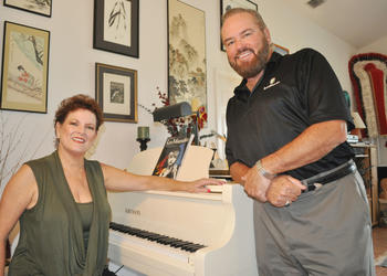 Carol Sparrow and Randolph Locke teach performers from the comfort of their home, where they have two pianos and high ceilings. Exotic artifacts, from their time singing across the globe, decorate their walls.