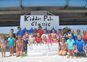 Children and parents raised $1,200 for Face Autism Inc., at the Kiddie Pole Classic Fishing Tournament 2013.