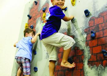 Reece Wilson and Jeremia Hernandez show no fear climbing to the top of the rock wall.
