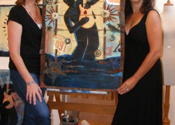 Mary GrandPre and Paula Murray pose with the 2012 Bradenton Blues Fest poster.