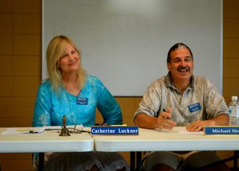 Siesta Key Association board members Catherine Luckner and Michael Shay discuss a proposal to dredge Big Pass.