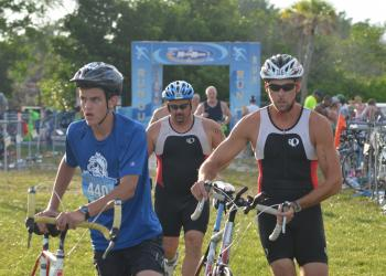 Athletes get ready to mount their bikes and take off during the transition of the Siesta Key triathlon this weekend.