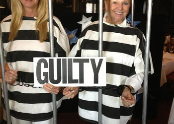 Partners in crime: Susan Phillips and Phyllis Black were 'arrested' Wednesday, Aug.7 for MDA's Lock-Up. Courtesy photo.