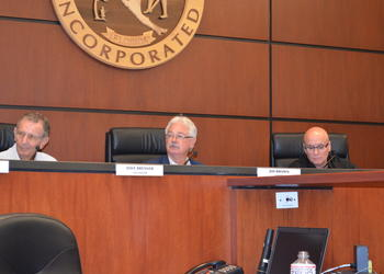 Mayor Jim Brown, middle, cast the deciding vote Monday that approved two additional retirement incentives for general employees before their pension plan is frozen next month.
