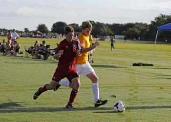 Tallahassee United's Ian Hildebradnt and FC Sarasota's Cameron Roscamp battle for possession.