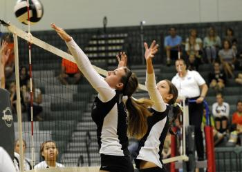 Lakewood Ranch senior Lauren Owen goes up for a block during the Lady Mustangs 3-0 victory over Sarasota Sept. 3.