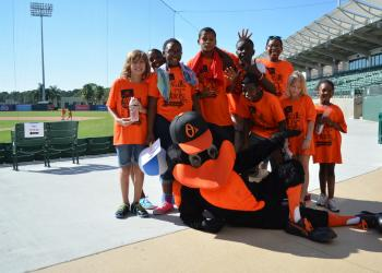 Oriole the Bird poses with some of the kids at the 2013 Walk for the Kids event.