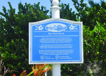 A historic marker on Broadway commemorates the old town dock that was destroyed in a 1921 hurricane.