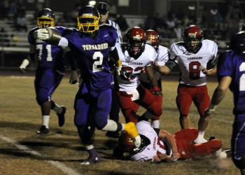 Booker running back Marlon Mack scored on runs of 6, 82, 24 and 85 yards to lead the Tornadoes to a 26-14 victory over Cardinal Mooney Nov. 8.