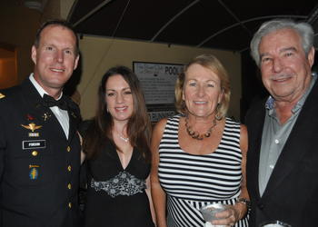 Mike Forson, who currently serves in the Army National Guard, with his wife, Angela, and Robyn and Howie Drourr of Michael Saunders & Company, an event sponsor