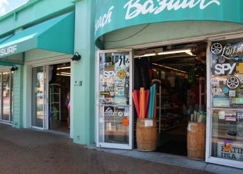 Souvernir displays are kept within the doorway at the Beach Bazar in the Siesta Key Village, abiding by a county ordinance that bans Siesta merchants from outdoors displays of merchandise.