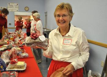 Donna Leuchter, with a loaf of homemade pumpkin bread, at last year's Christmas Bazaar. (File photo)