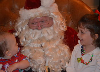 Finley and Madison Anderson tell Santa what they want for Christmas