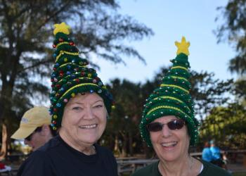 Shirley Matchett and Debby Frederick wear homemade Christmas hats.