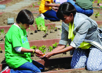 Emilio Vega, an 11-year-old Gullett Elementary School student from Colombia, was one of two students chosen to work side-by-side with first lady Michelle Obama as she planted a garden at the White House April 4.