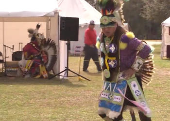 Leland Thompson performs a pow wow dance imitating the movements of the prairie chicken at the Sarasota Native American Indian Festival.