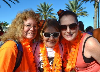 Sharon Morehouse, Amanda Sessions and Crystal Schroeder show off their orange pride.