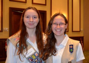 Seventeen-year-olds Megan Reynolds and Emily Sisk sport their Girl Scout vests.