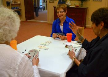 Robin Green laughs during a fun game of bridge.