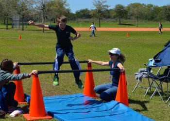 Ten-year-old Austin Parcels jumps during the school's obstacle course.