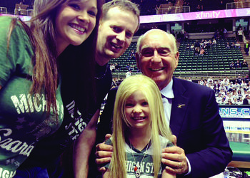 Heather and Matt Hols-worth, with Dick Vitale, and their daughter, Lacey. Courtesy photo
