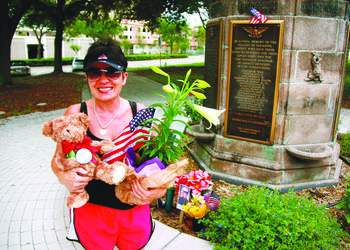 Elizabeth Woodall visits the Sarasota War Memorial to pay tribute to her son. (Photo by Nolan Peterson)