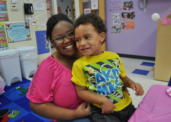 Michael Lawson sits with her son, Malachi, 3.