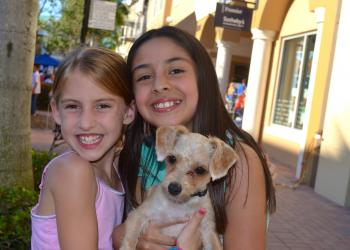 "Rachel Small and Valeria Erazo say ""cheese"" beside their furry friend, Biscuit."