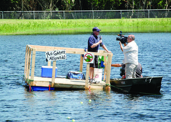 A Channel 7 WWSB ABC news reporter interviews Principal Bill Stenger by the raft. Photo by Laurie Rahn