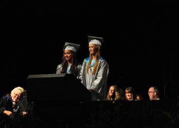Victoria Najmy and Kayla McNulty jointly give a speech.