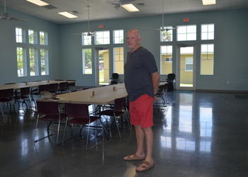 Paul Welch stands in First Step's newest addition, the Welch Family Foundation Community Room.