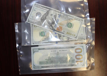 The men attempted to use counterfeit $100 bills at three different 7-Eleven locations.