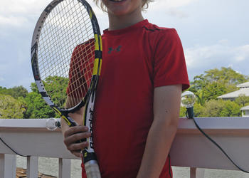 "ODA fourth-grader James Gelvin looks up to tennis star Roger Federer. ""His style is my kind of style,"" Gelvin says. ""He hits the ball the way I dream of hitting the ball — smooth and not flat."""