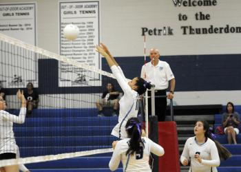 ODA senior Reanna Gregory sends the ball back over the net in the first set.
