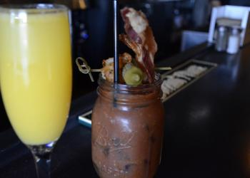 Stacey Rhoads, a bartender at Blue Rooster, said she's gotten lots of surprised reactions from tourists who want to order a mimosa or bloody Mary with Sunday brunch — only to find out they can't before noon.