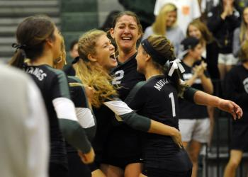 Layne Thompson, Nicole Grant and Kelley Ainsworth celebrate following their 3-0 victory over Fort Myers in the Class 7A-Region 3 finals Nov. 8. Photos by Jen Blanco