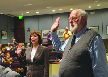 The city auditor and clerk swears in Eileen Normile and Stan Zimmerman Wednesday. Photo by David Conway