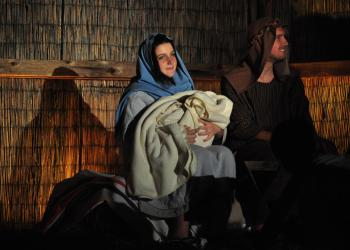 Alayna Montgomery and Caleb Jordan, as Mary and Joseph, hold the newborn baby Jesus, played by 2-month-old Daniel Lawson.