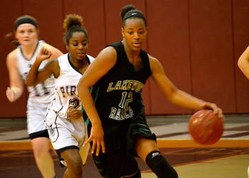 Aleah Robinson dribbles the ball down the court.