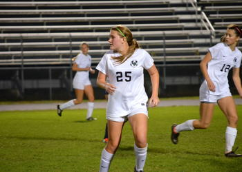 Carly Mitchell watches the ball before moving down the field.