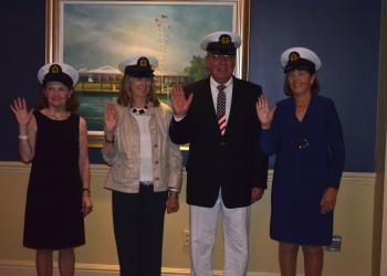 Scribe Maureen Shea, Purser Mary Kimura, Vice Commodore Jim Fox and Commodore Kathy Sever are sworn in.
