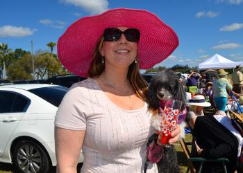 Keffie Lancaster and her dog, Koukla, enjoy a breezy afternoon and a polo match.