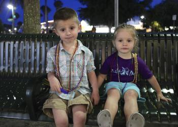 Brennan Duffy, 4, and Kayla Duffy, 2, enjoy their beads at 2014's Mardi Gras St. Armands Style.